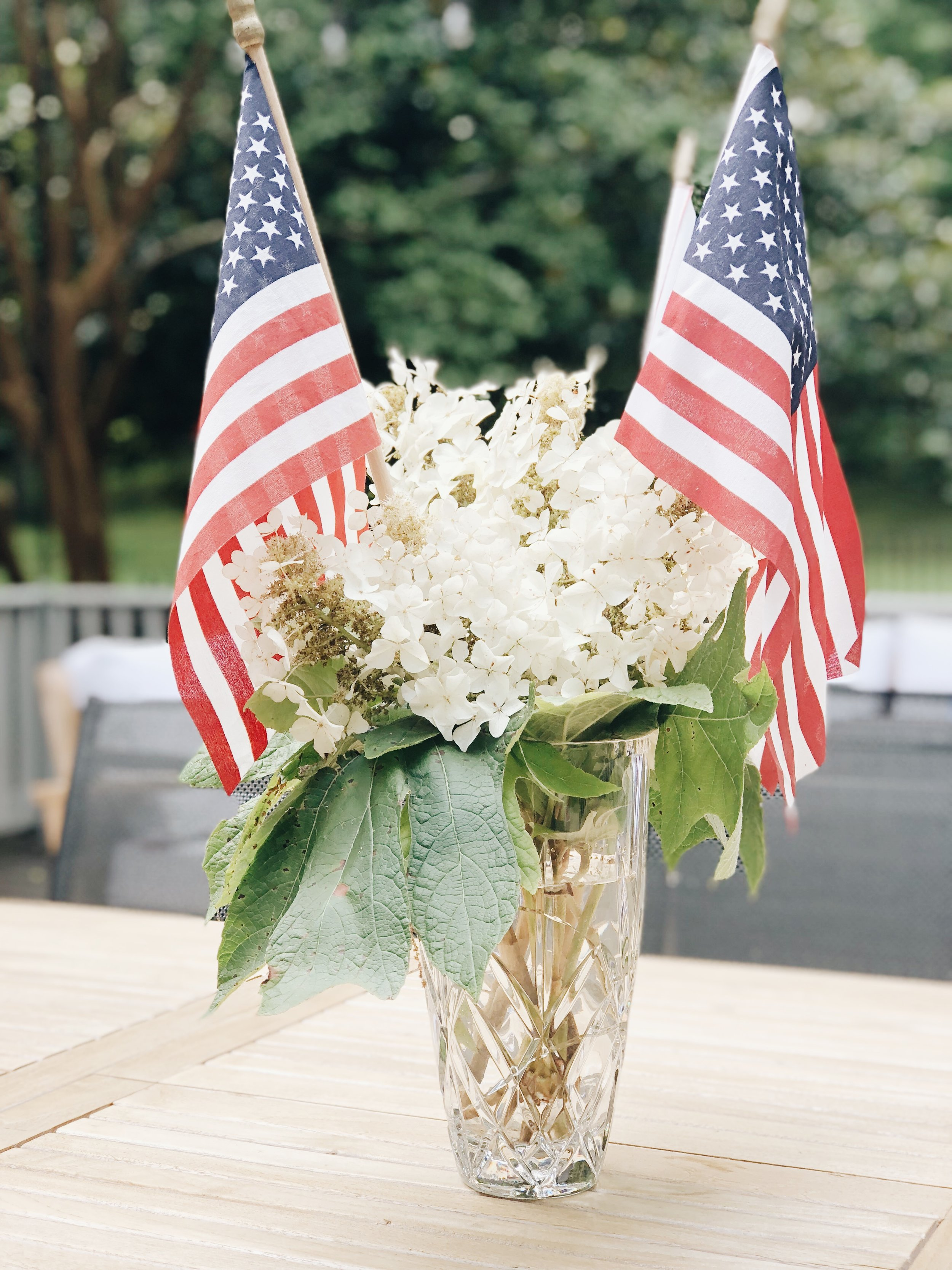 I love this  Waterford Crystal  vase. I especially love it with hydrangeas and these American Flags. This is perfect for any patriotic holiday.