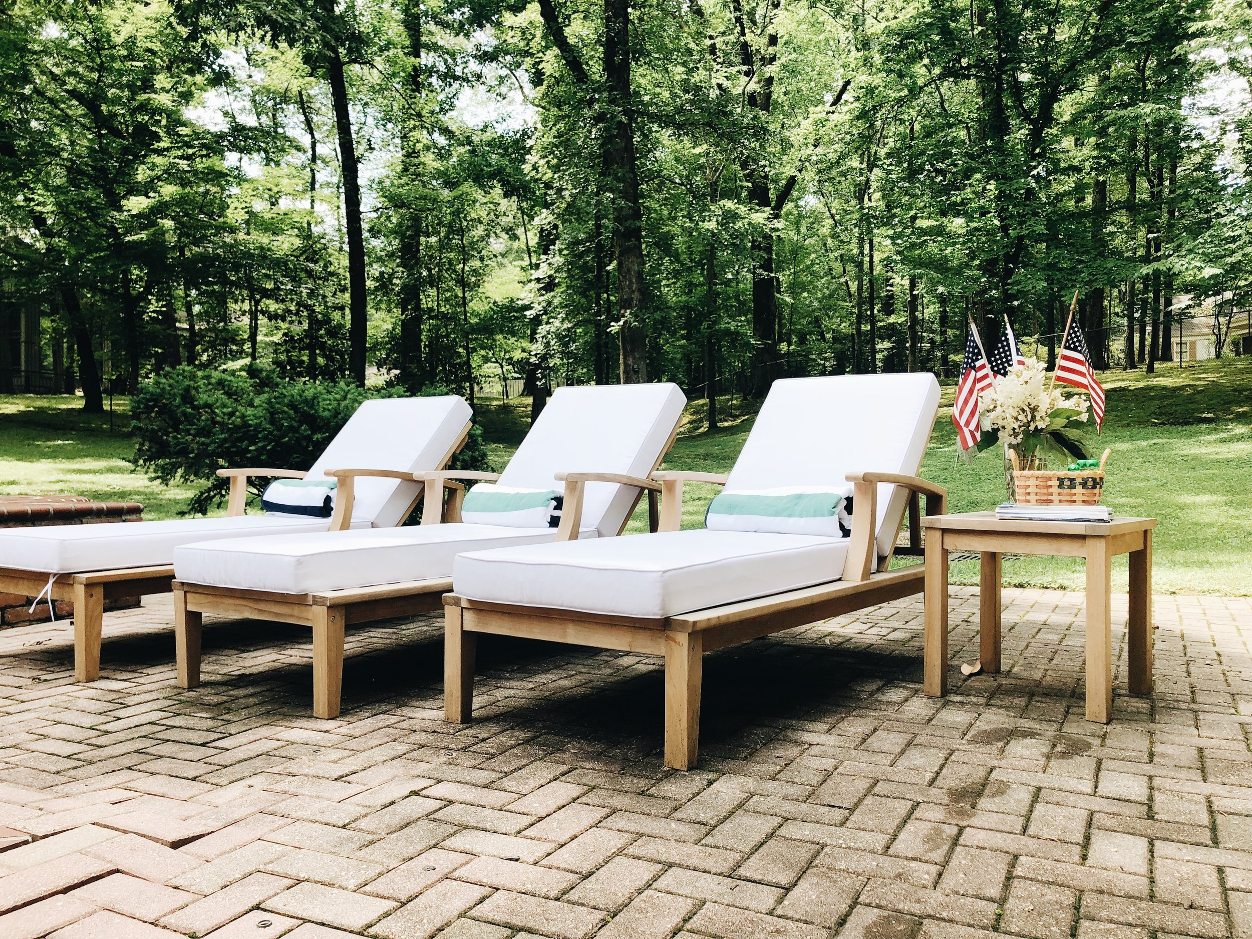 I could not love these teak lounge chairs anymore. These  L  aguna Beach towels  complete the look. These are my favorite pool towels.