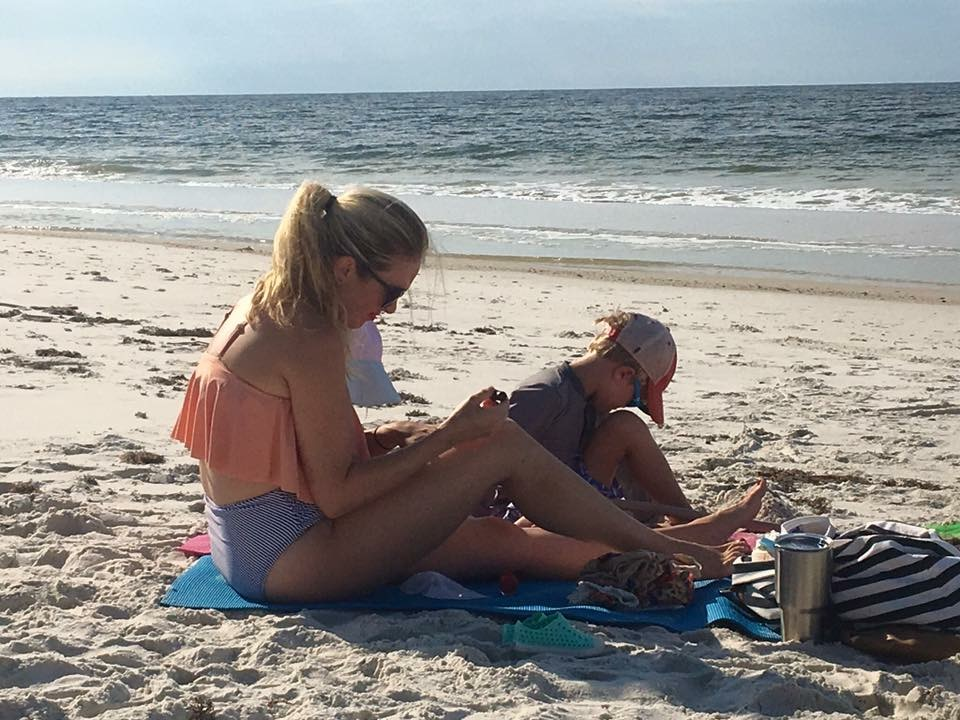 Recovering, the week after, at the beach with all 3 babies right beside me + daddy snapping the picture.