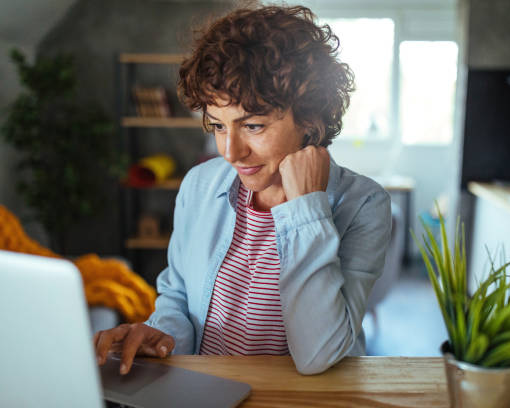 Photo of mature woman working at home