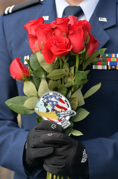 A member of the CU Air Force ROTC holds roses and the Challenger space shuttle patch during the memorial Saturday honoring University of Colorado alumni Ellison Onizuka and Kalpana Chawla, astronauts who died in NASA space shuttle accidents and their crews. January 28th was the 30th anniversary of the Challenger accident. David R. Jennings Staff Photographer January 30, 2016