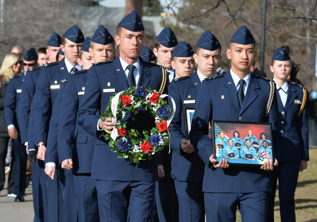 The Air Force ROTC unit slow marches during the ceremony on Saturday for University of Colorado alumni Ellison Onizuka and Kalpana Chawla, the astronauts who died in NASA space shuttle accidents and their crews. David R. Jennings Staff Photographer January 30, 2016