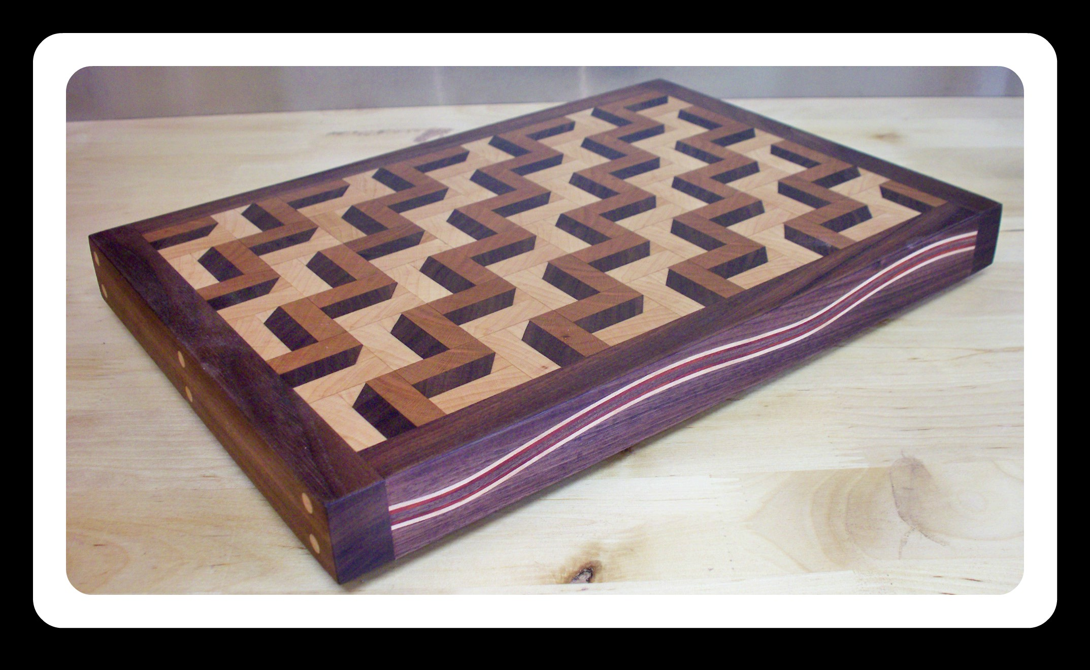Chad Sanders - Baton Craftsman and builder of many other fine wood products including this award winning cutting board.