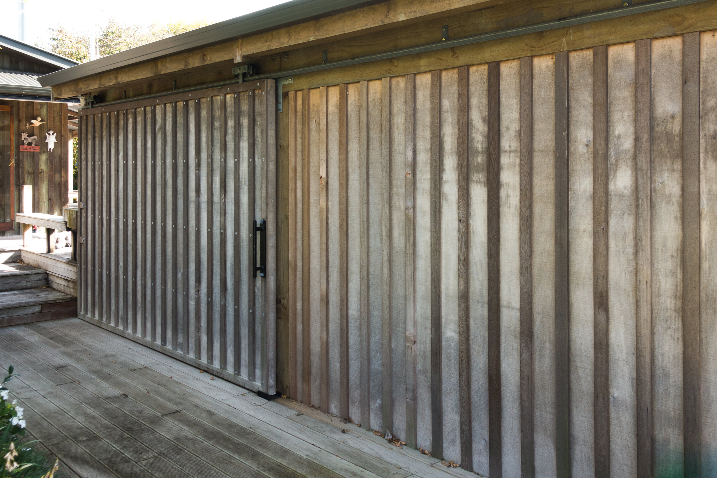 DividingDoor - Sliding door we fabricated for a clients outdoor entertainment area.