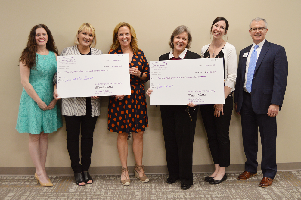 The Women's Fund of Porter County awards their 2019 grants to Dunebrook Inc. and Dressed for School at their Annual Membership Meeting at the Porter County Community Foundation in Valparaiso. (Left to right) Stephanie Jones (Women's Fund of Porter County), Lisa Hauser (Dressed for School), Julie Douglas (Dressed for School), Jeanne Ann Cannon (Dunebrook, Inc.), Sara Hoyt (Dunebrook, Inc.) and Bill Higbie (Porter County Community Foundation).