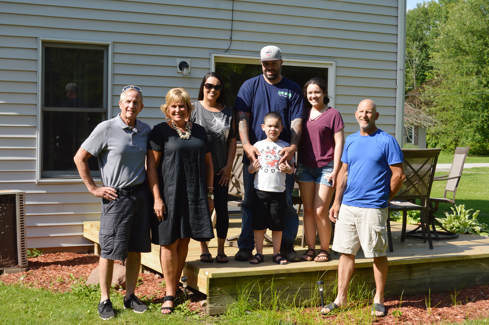 The Lenburg family along with Rebuilding Together Duneland volunteers on their new deck. ( left to right ) Jim Thorstad (Rebuilding Together Duneland Volunteer), Desila Rosetti (Porter County Community Foundation Board Member), Patty, Jim, Dylan & Hannah Lenburg, and Cliff Zosso (Rebuilding Together Duneland Volunteer).
