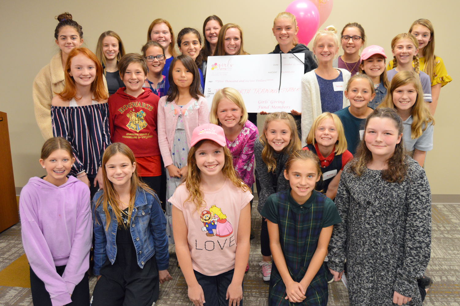 Members of the Girls' Giving Fund awarded their 2019 grant to True North Training Stables, represented by two of their interns.