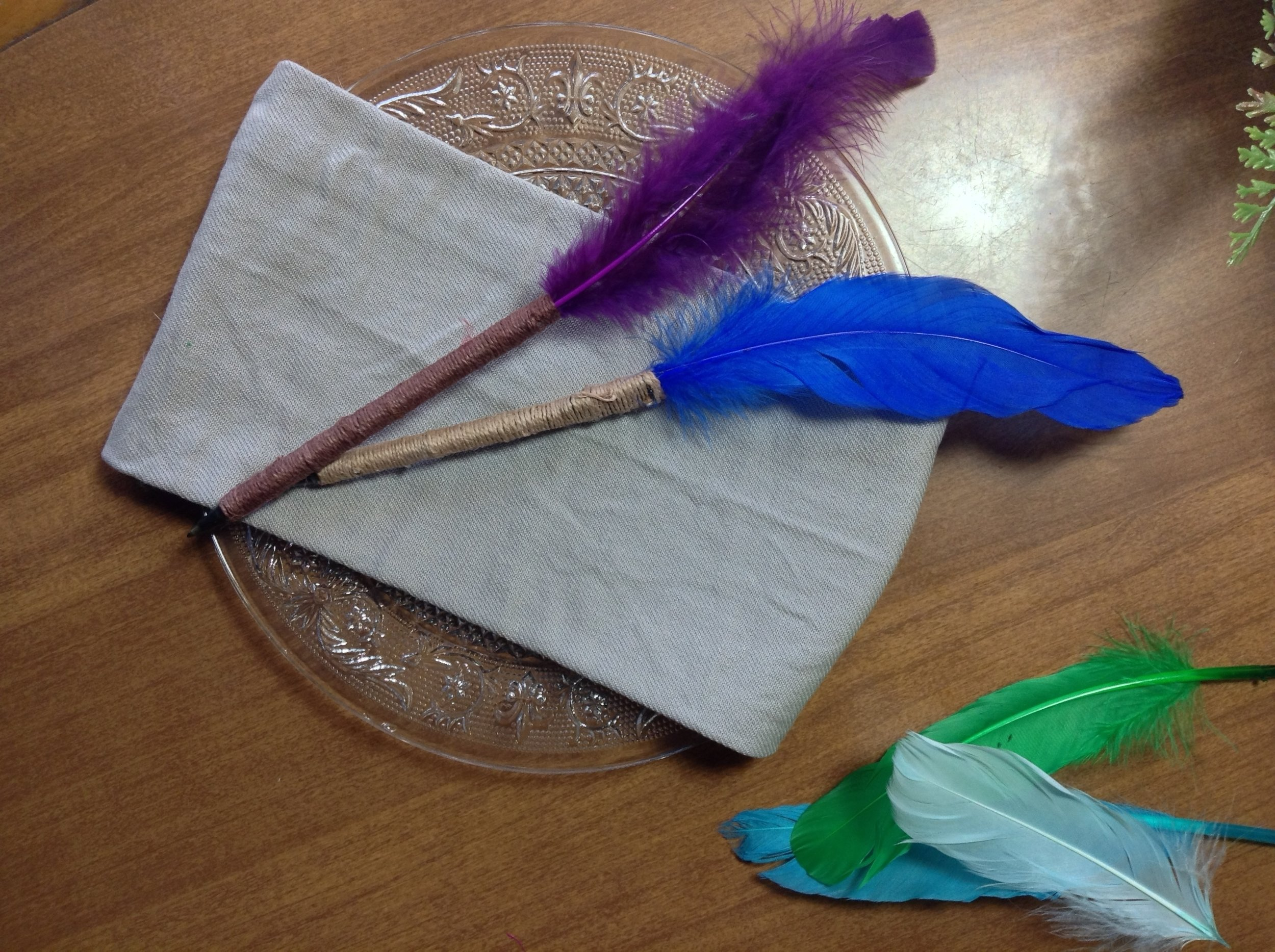 Get extra crafty - Add other embelishments like gems or pearls, or keep it simple by using natural colored feathers! This is a great project to get your wedding party or friends involved and have fun!