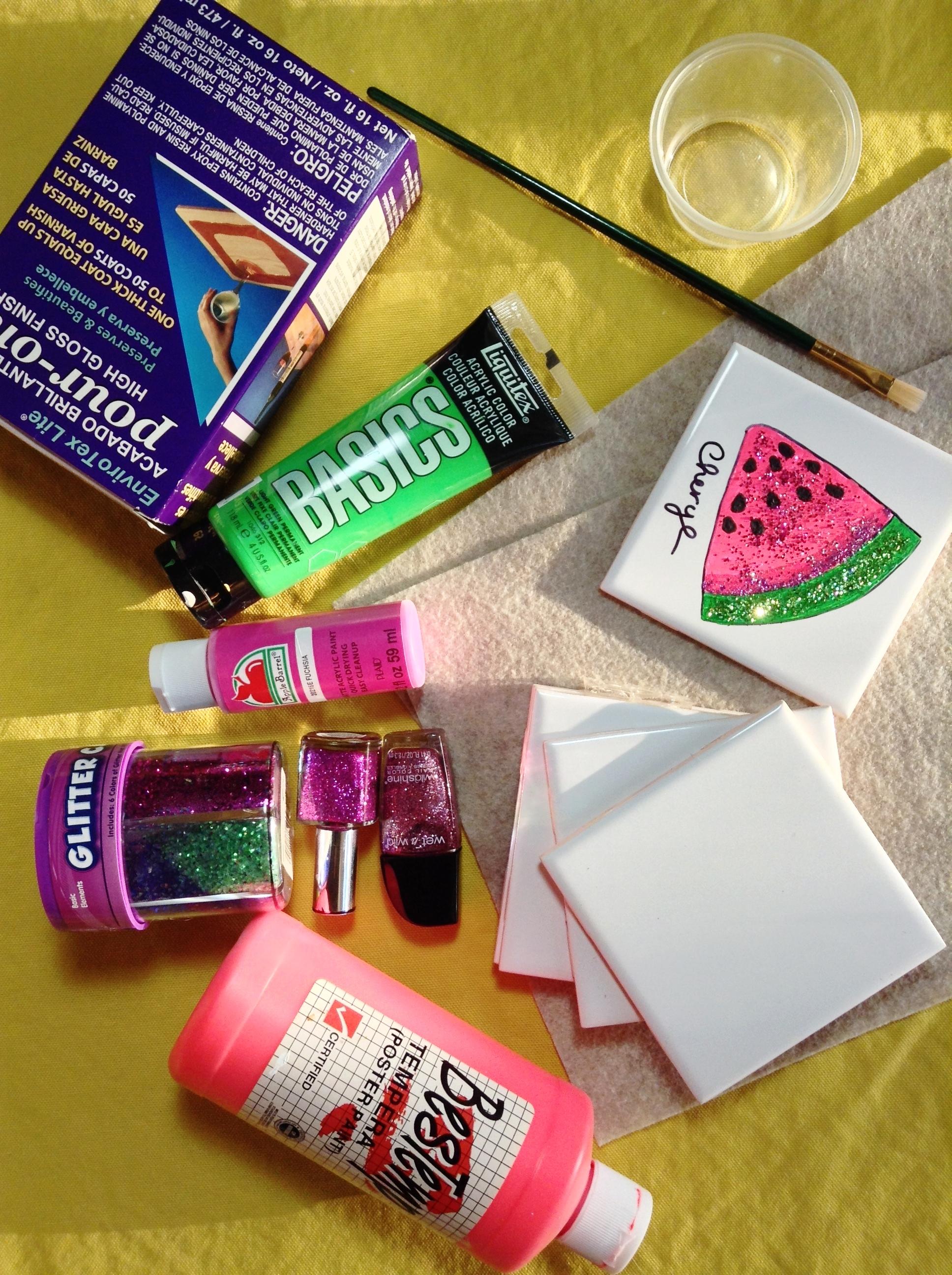 Supplies/Product List - -Ceramic tiles- Thrift store/Lowes-Paints or scrapbook paper- Michael's Arts & Crafts-Glitter- Glitter Caddy & nail polish-Mod Podge-Sealant- Enviro Tex Lite- Michael's Arts & Crafts-Felt squares- Michael's Arts & Crafts-Black marker- Sharpie