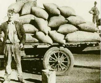 Unloading bags of rice.JPG