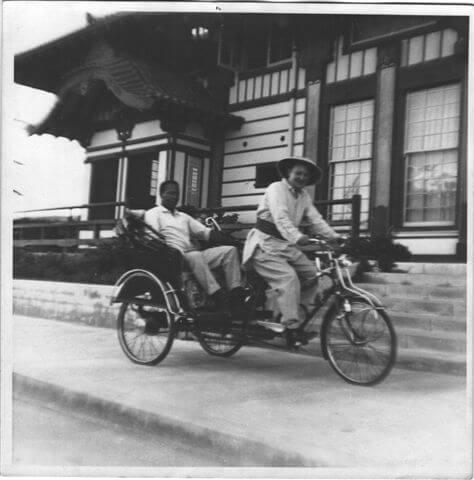 thomas-o-glover-driving-rickshaw-1950s.jpg