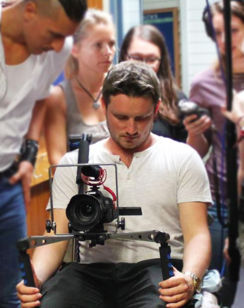 Eddie Marriott filming with a camera for a short film / video