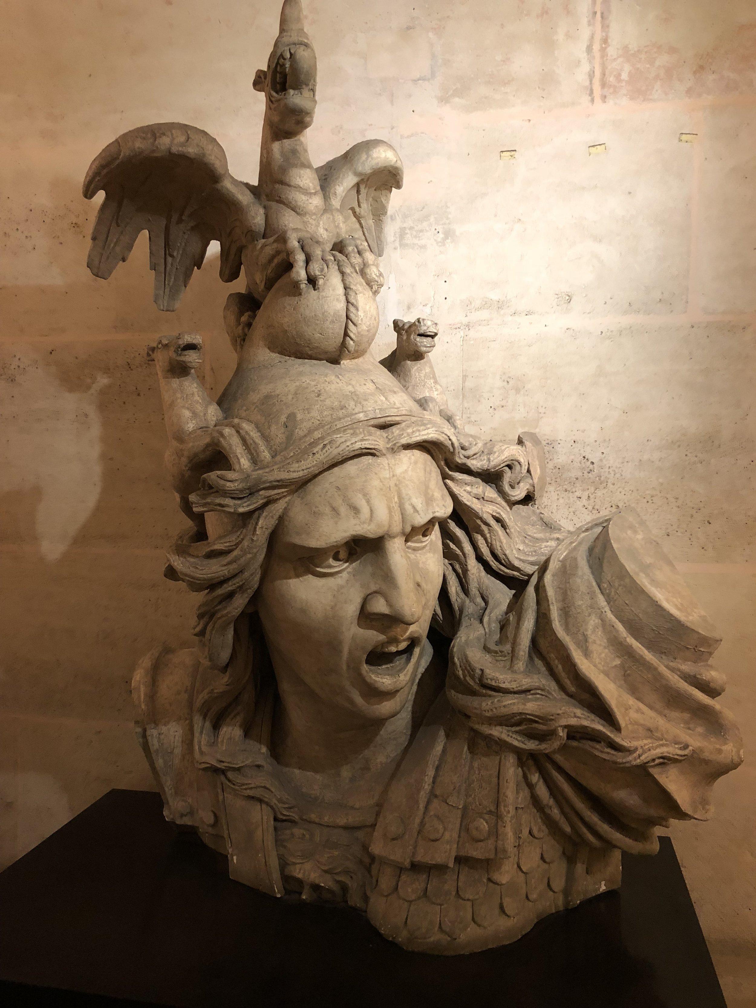 "Stored inside the  Arc de Triomphe , presumably a backup bust of  Le Depart de  Volontaires  de 1792  (aka ""La Marseillaise"")."