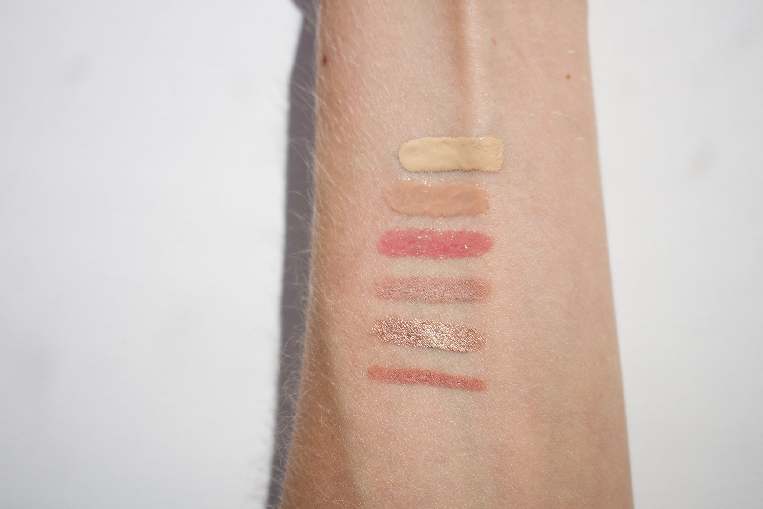 Swatches from top to bottom (in direct sunlight): Great Skin Foundation in 75, Superglazy Moisture Lip Gloss In Neutral, Shine Up Lip Colour Balm in Pillowy Pink, Moisture- Lock Wondergel Lip Liner in Vanilla Nude, Wondercolor Longwear Cream Shadow Sticks in Pink Velvet and Little Star.