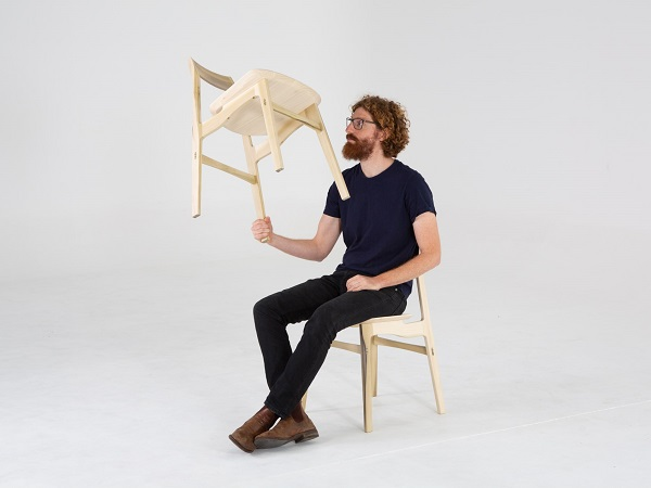 Adam Markowitz with the Flea Chair available through  Markowitz Design