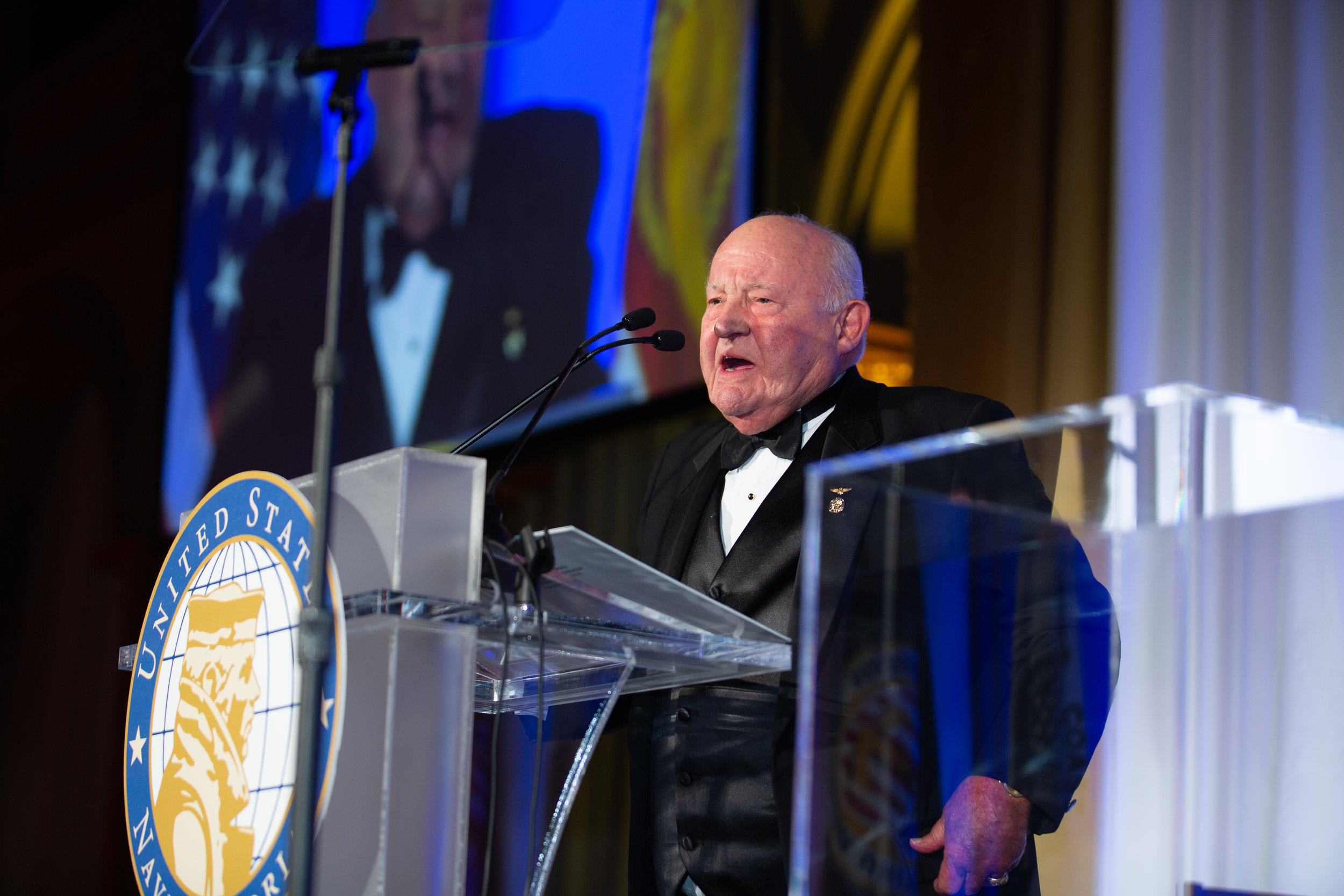 "Dr. J. Phillip (Jack) London introducing Medal of Honor recipient Harvey C. ""Barney"" Barnum Jr. at the 2018 Lone Sailor Awards Dinner in Washington, DC."