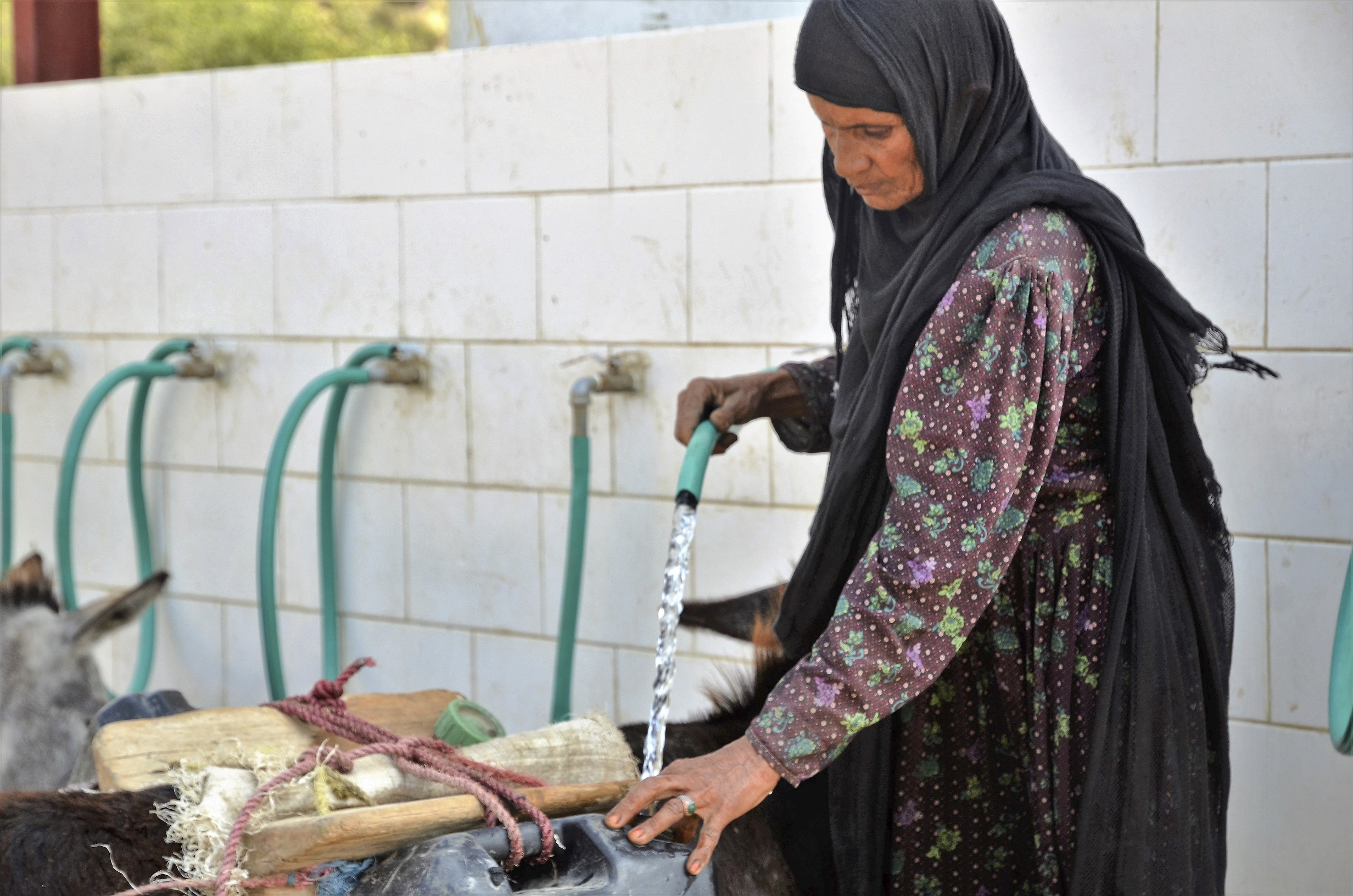 Photo caption: Hajja Khadija collects clean water from the water point constructed by Save the Children. Photo credit: Save the Children.