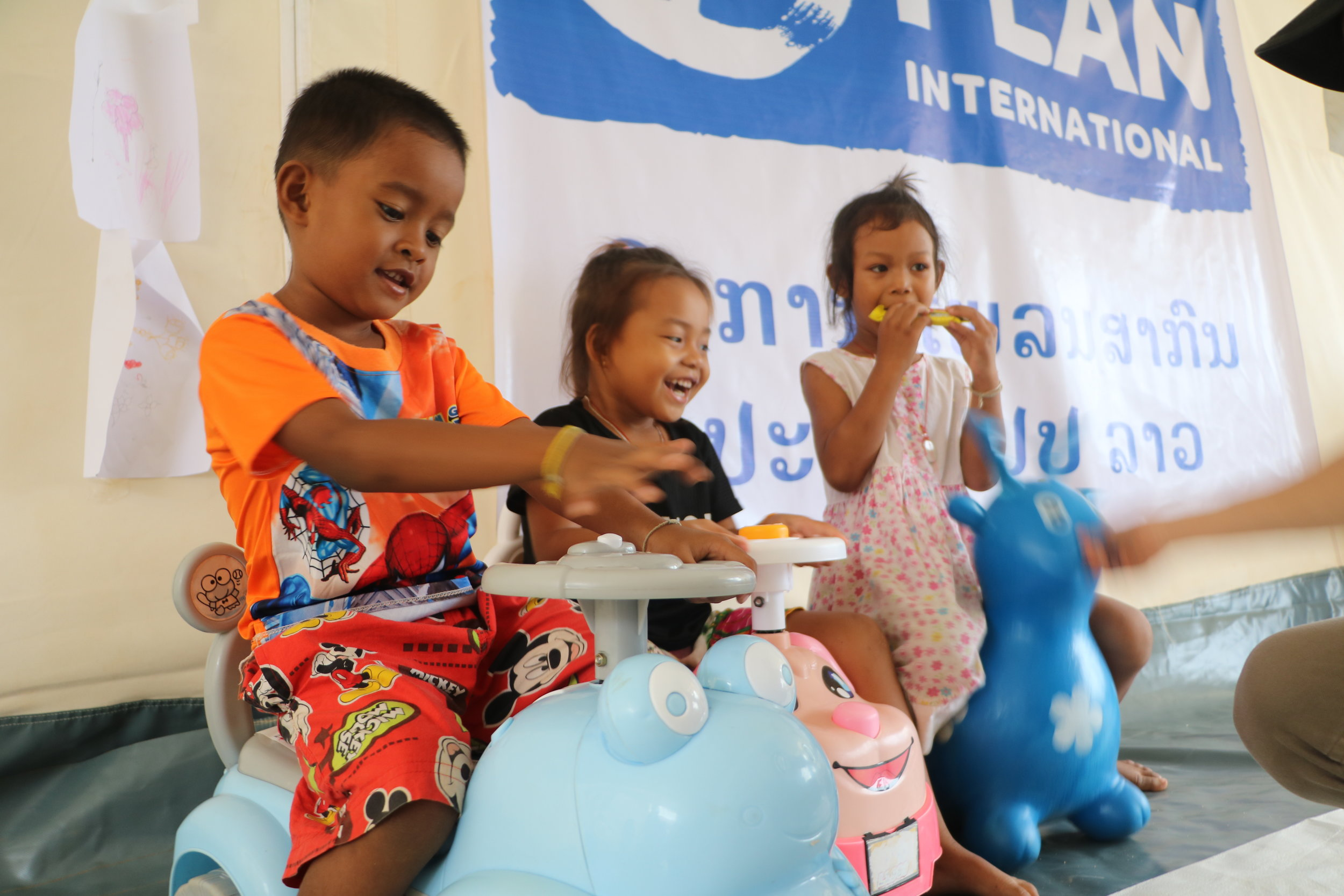 Above: Child-friendly spaces are set up in evacuation camps to help children with their recovery, and improve their learning skills through fun activities and games. Photo credit: Plan International.