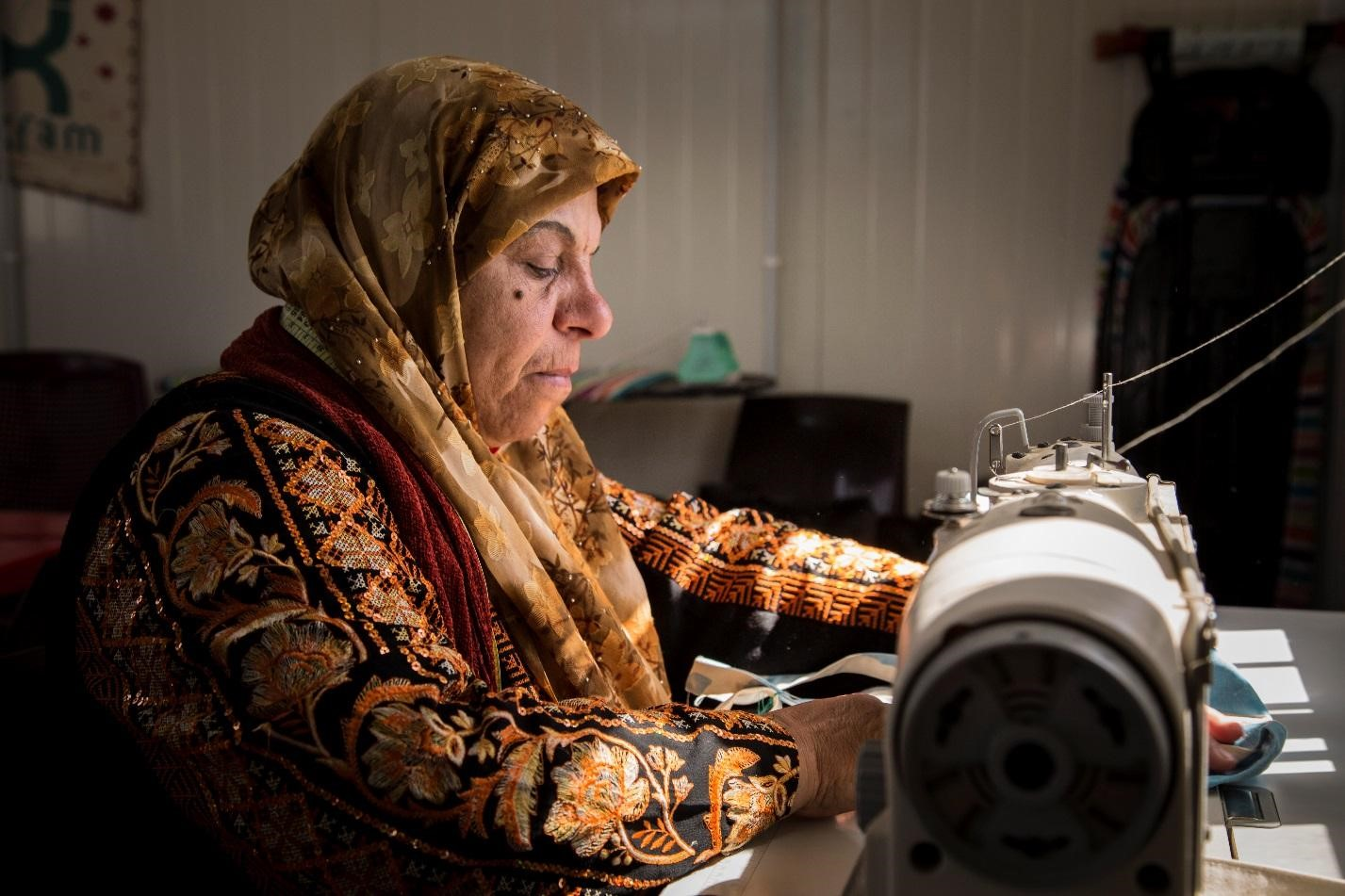 Above: Fatima sews bags from old refugee tents as part of an Oxfam project to support women in finding paid work. Photo credit: Nesma Alnsour/Oxfam