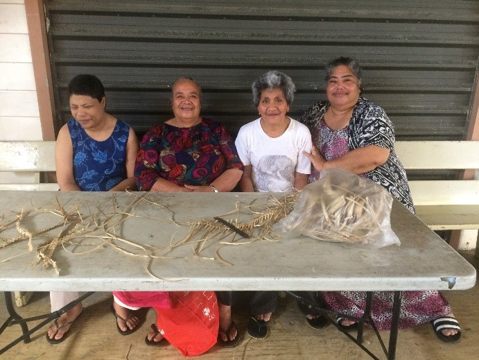 Above: Alonga Disability Centre (left to right) Kataloi Hoko (client), Sisilia Muimuiheatu (staff), Lavinia Fifita (client) and Oliveti Fungani (Manager) participating in a weaving activity. Photo: Charlie Damon, CARE Australia