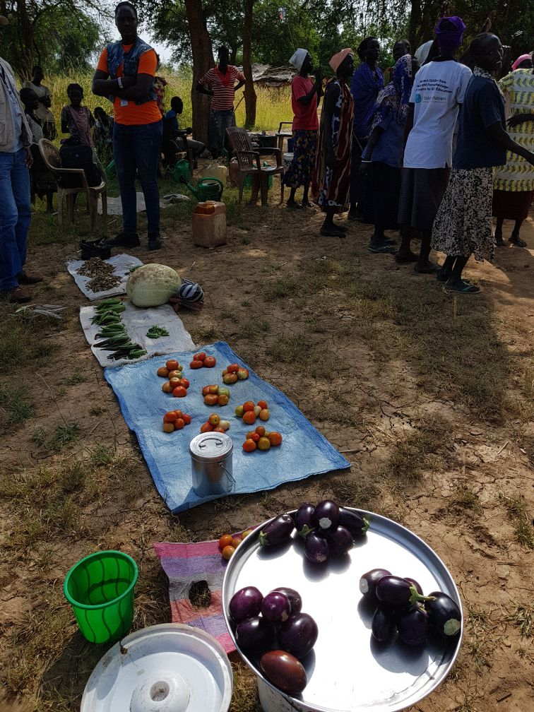 Above: Wathok community members and the produce grown as a result of World Vision's support. Photo credit: World Vision/