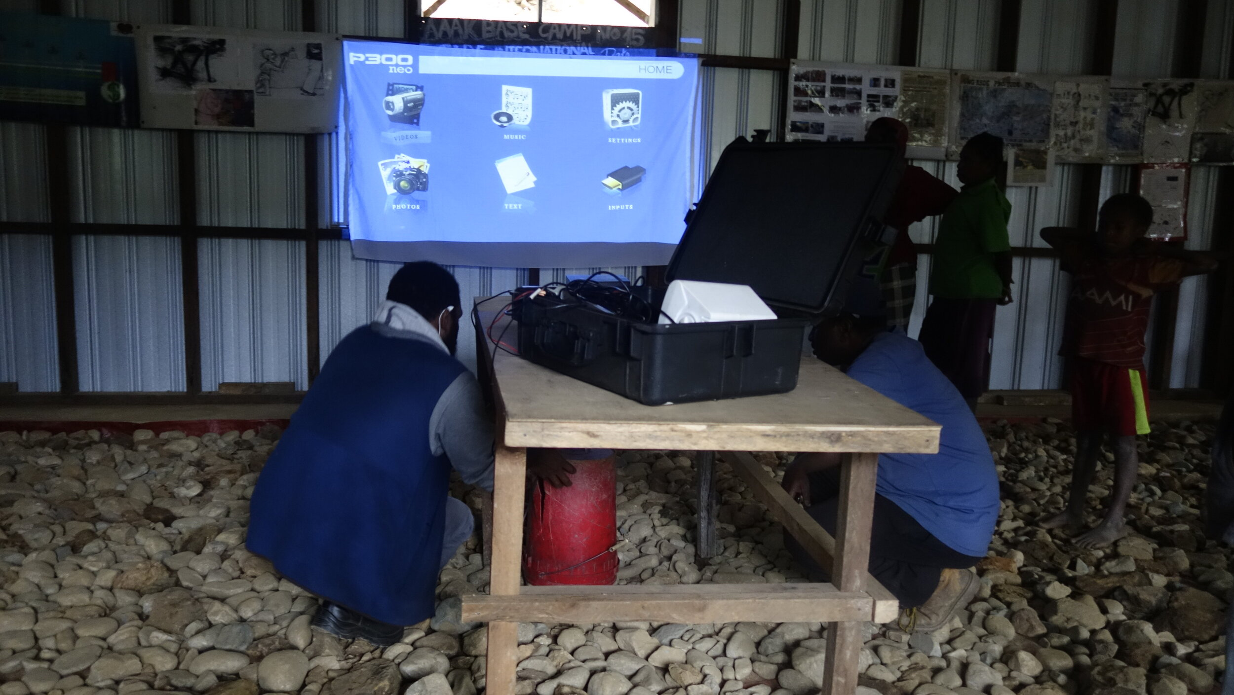 Above: The roving cinema kit was set up in the local villages to share informational videos.