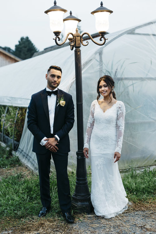 beautiful couple standing next to a lamp