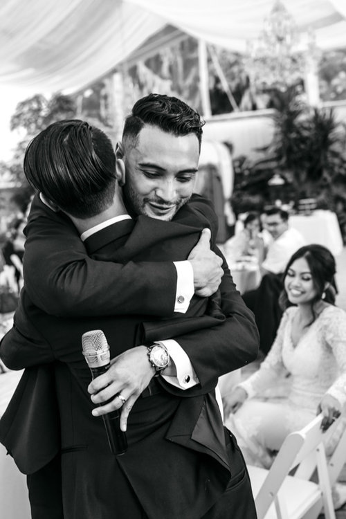 wedding guest hugging groom
