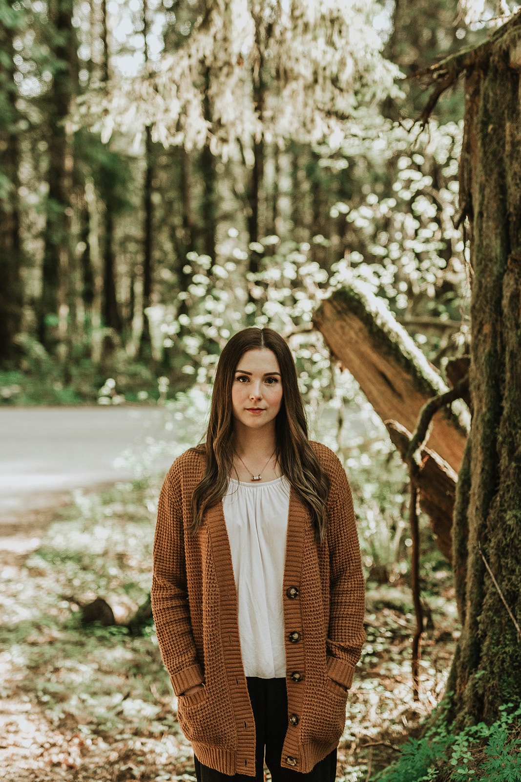 beautiful girl standing in forest