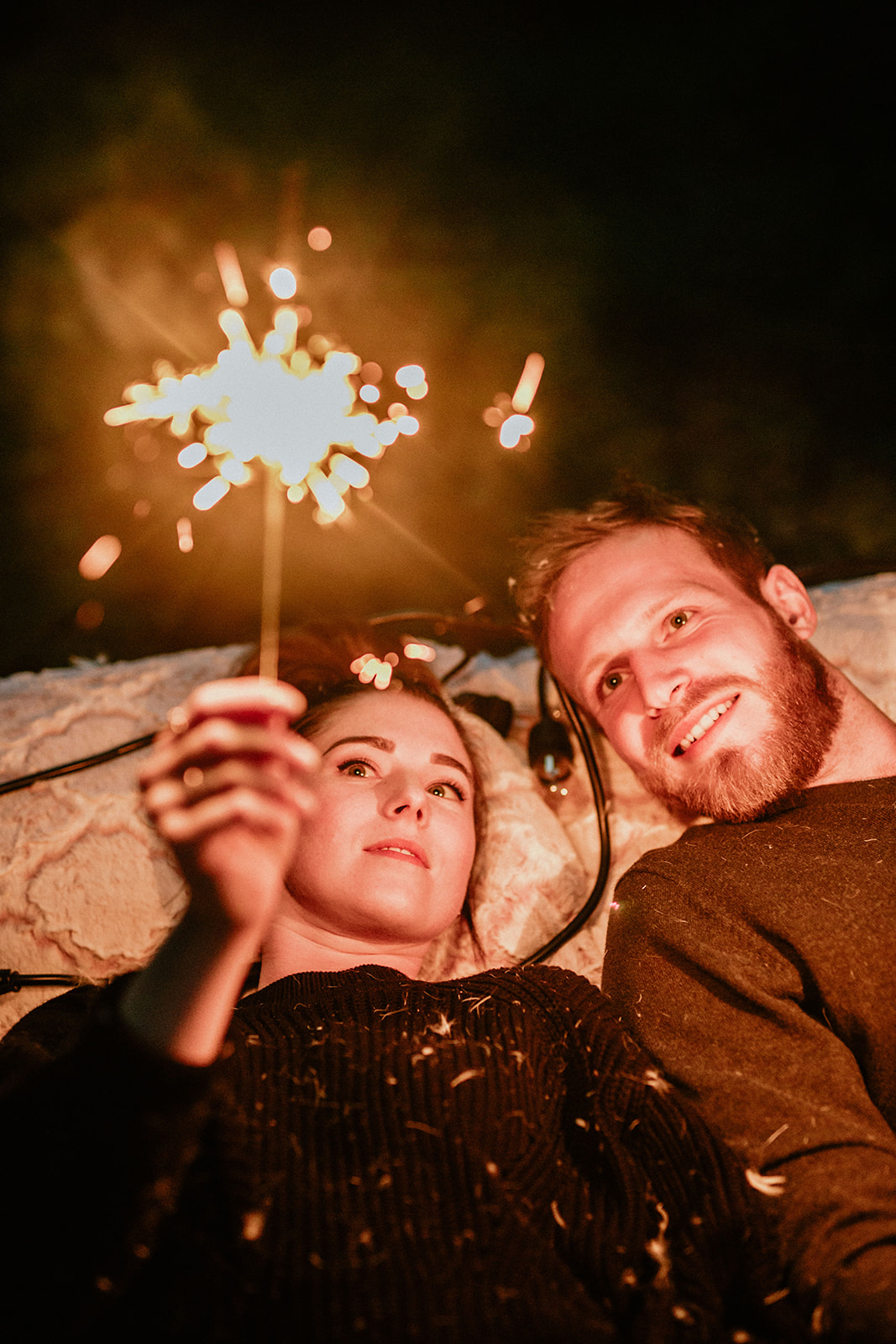 moody evening engagement session sparklers