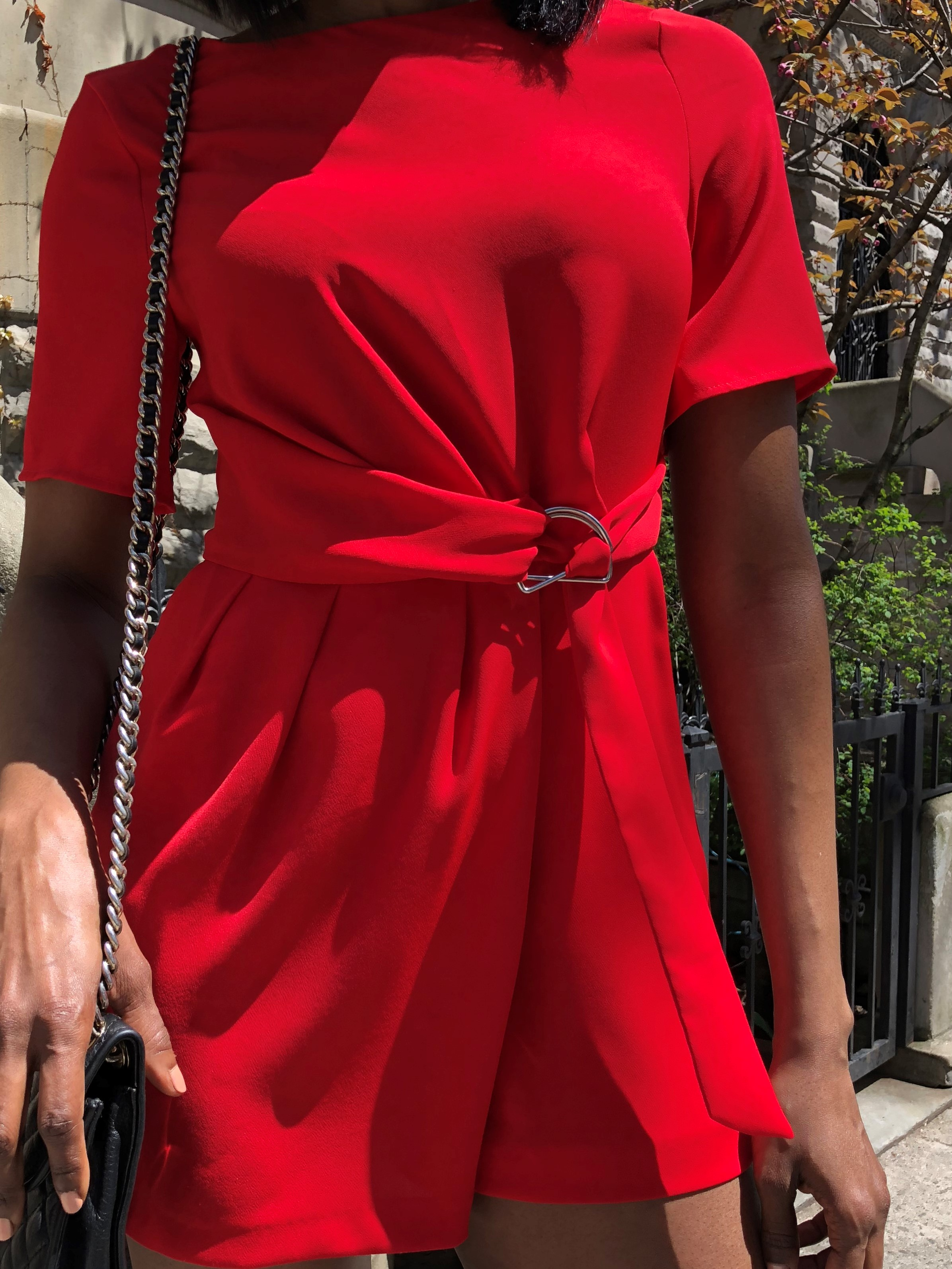 Red romper with pockets, silver hardware and tie