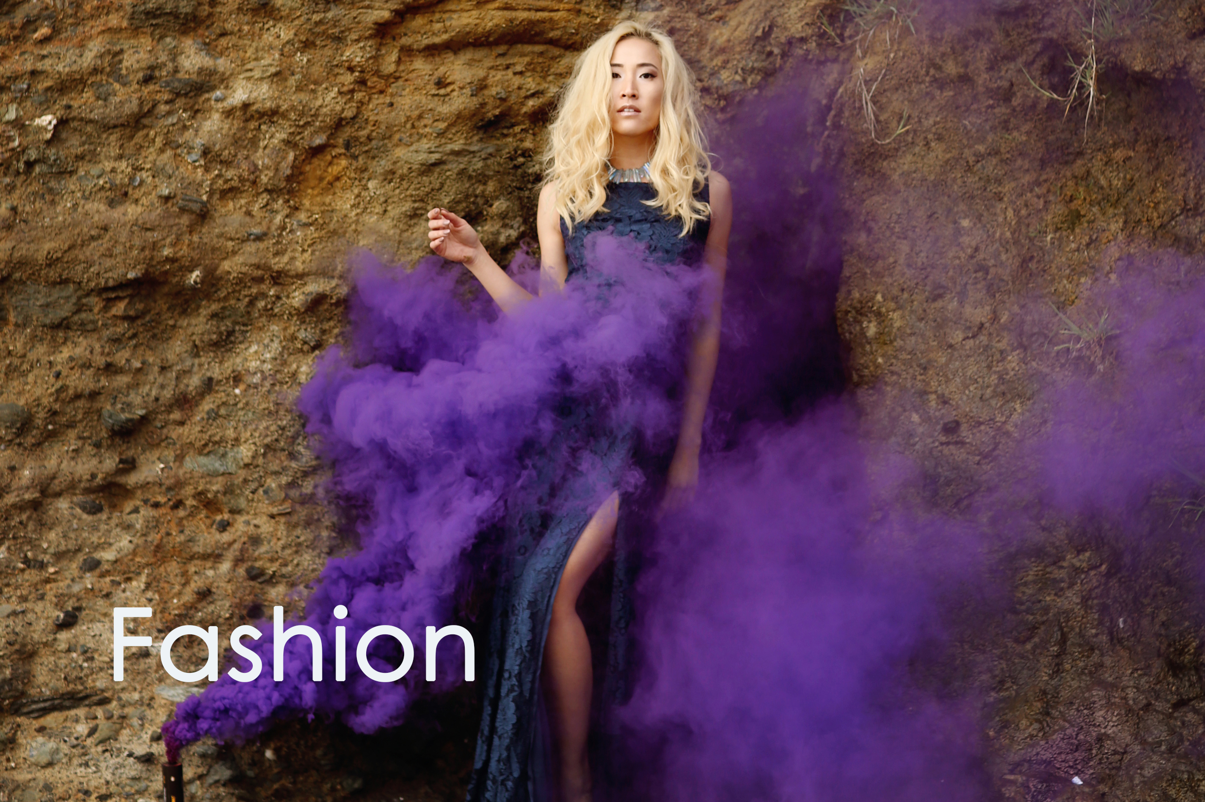 Purple smoke surrounds this fashion blogger photo of Orange County.