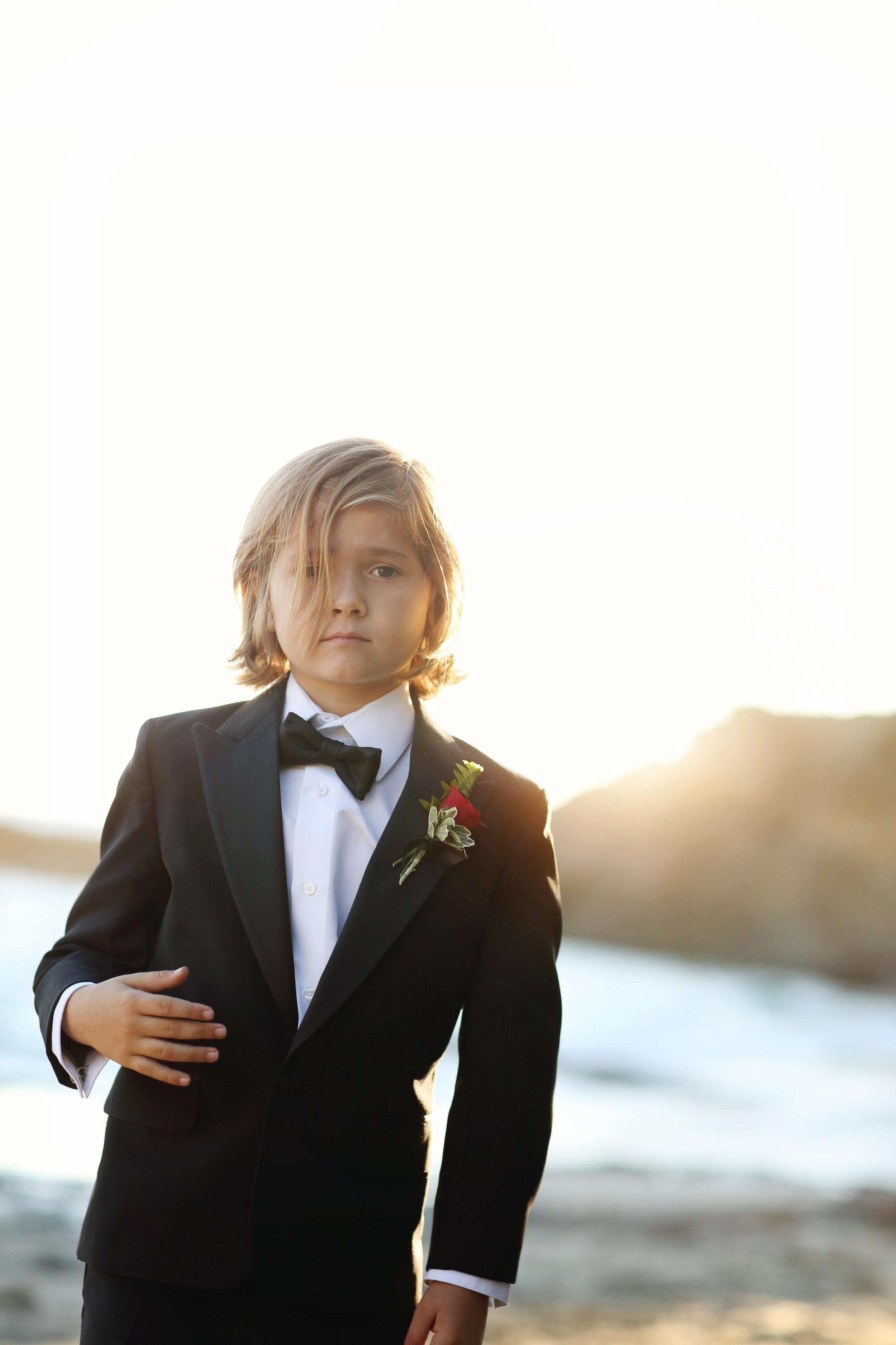 Beach Portrait of young boy in tuxedo at San Clemente Beach. Orange County