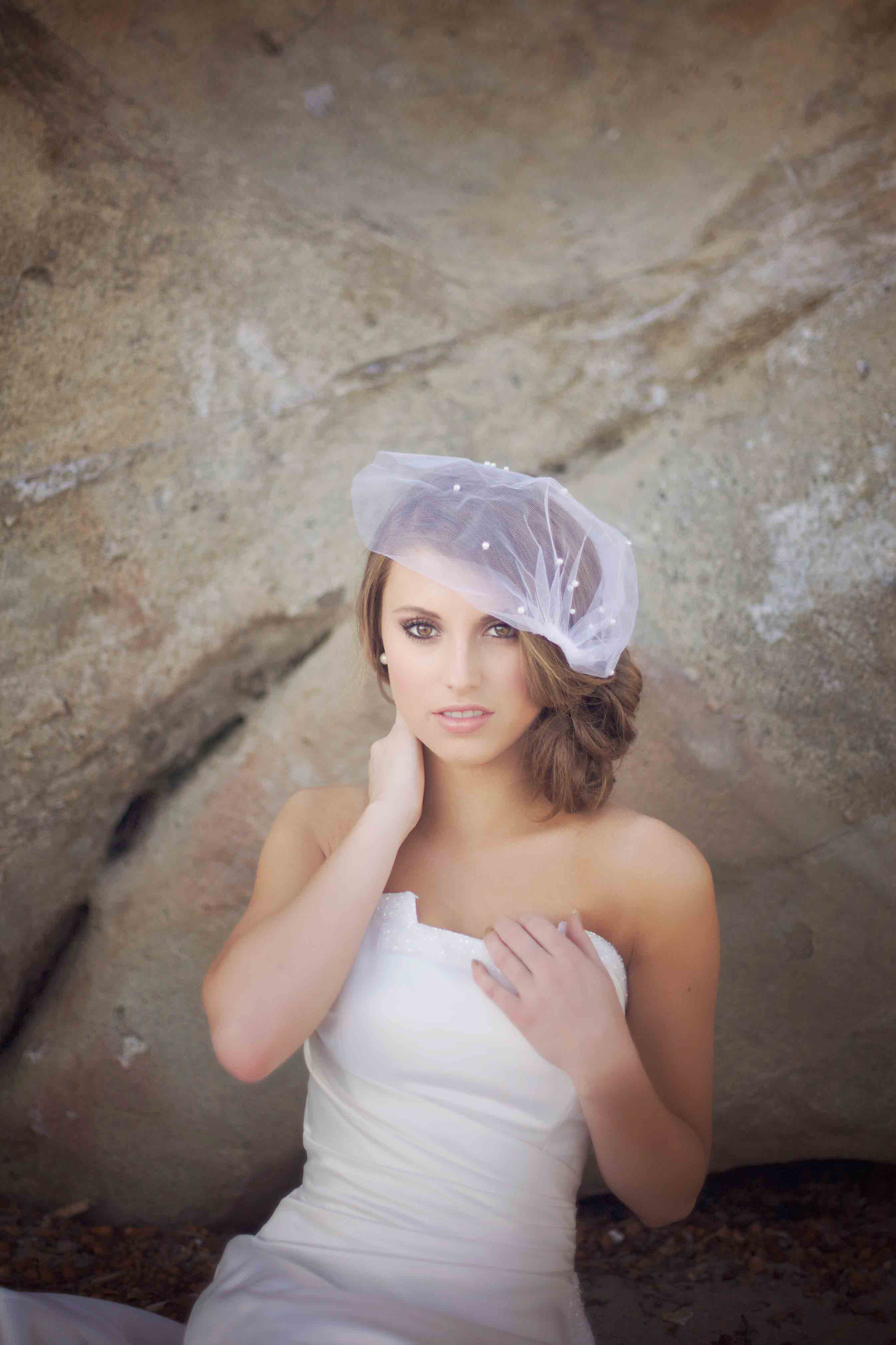 San Clemente Beach rocks are the backdrop for this lovely bride. Shot in Orange County California.