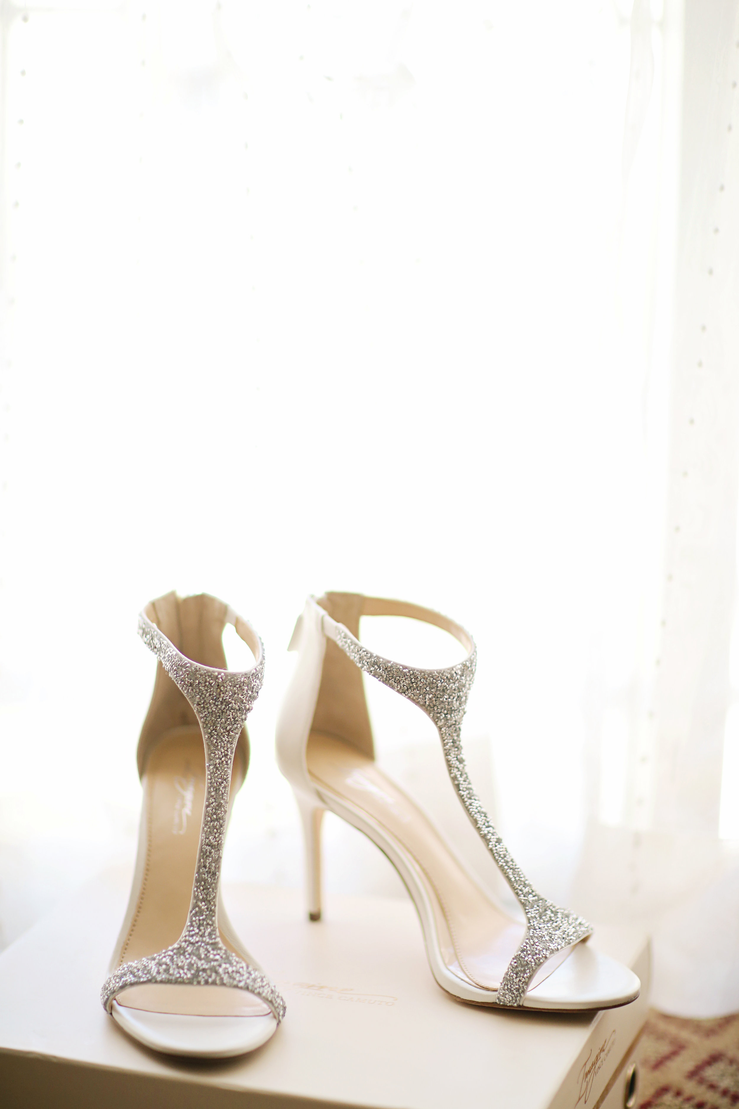 Bridal shoes are the subject of this wedding photo.