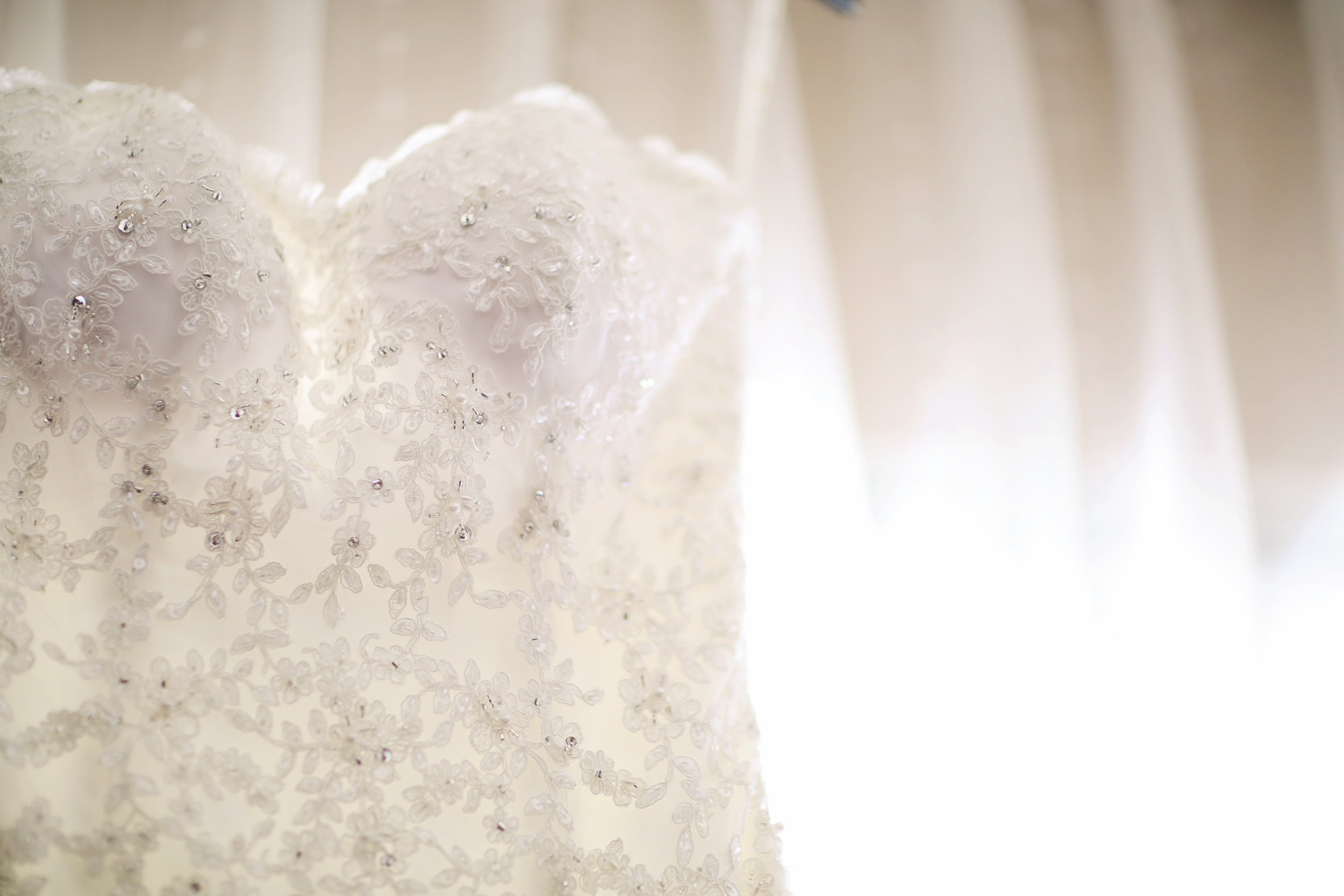 Beaded wedding gown is the subject of this wedding photo. Fine art photography.