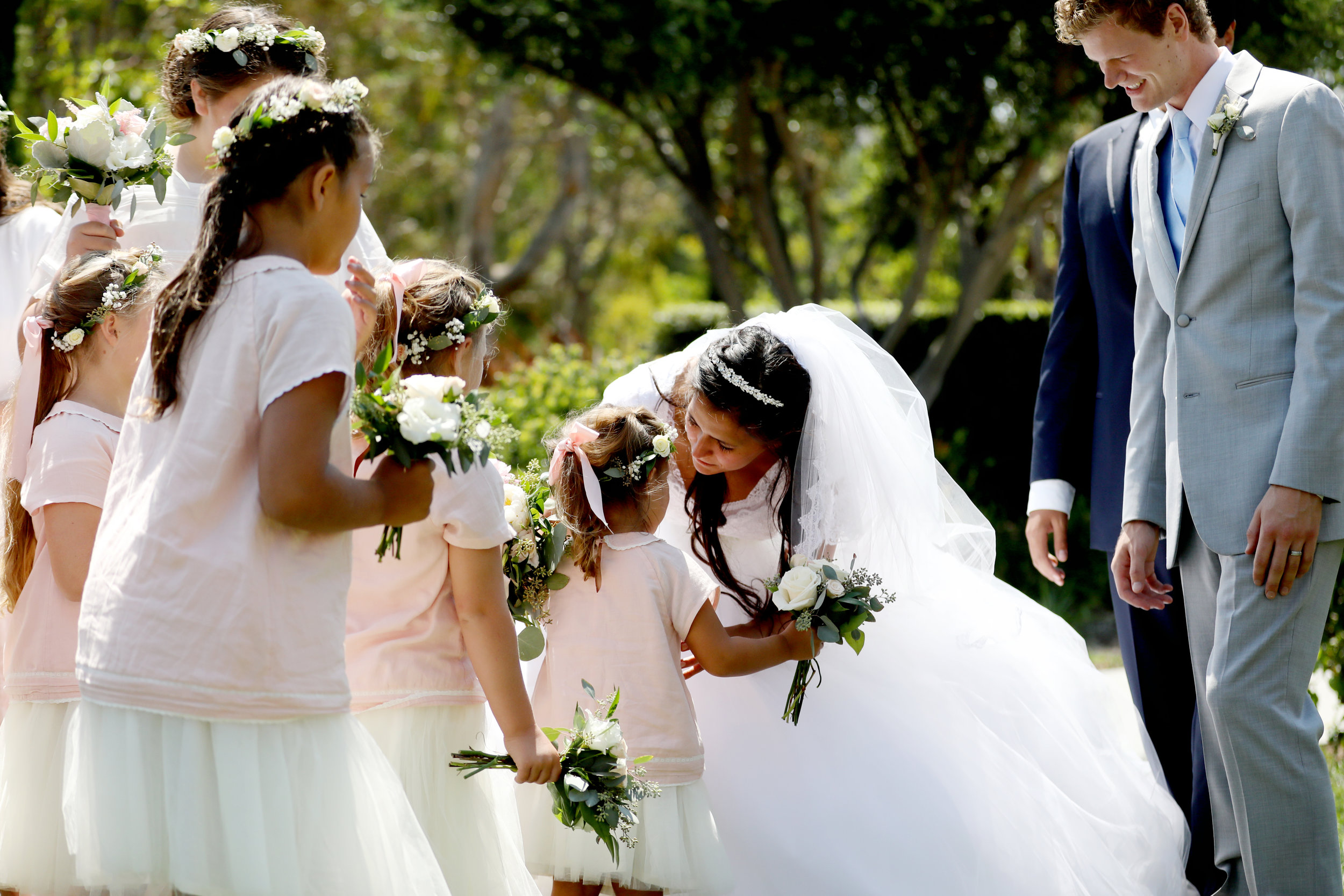 Bride with her bridesmaids and flower girl in this wedding photo of the entire wedding party.