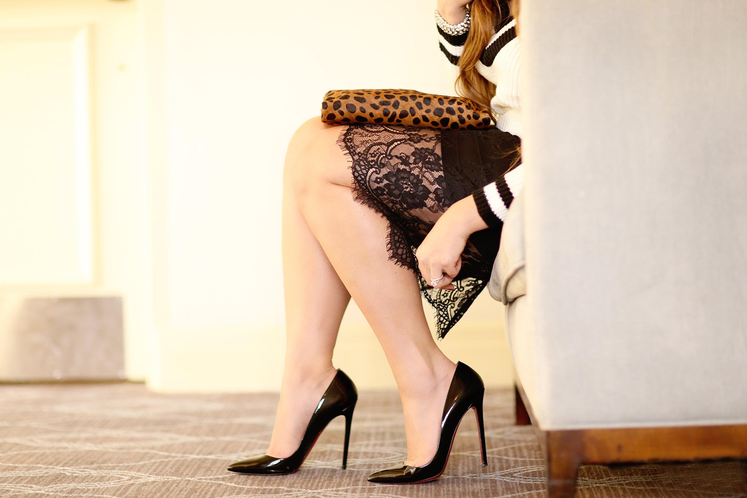 Fashion Blogger wearing patten leather black pumps. Fine art photo