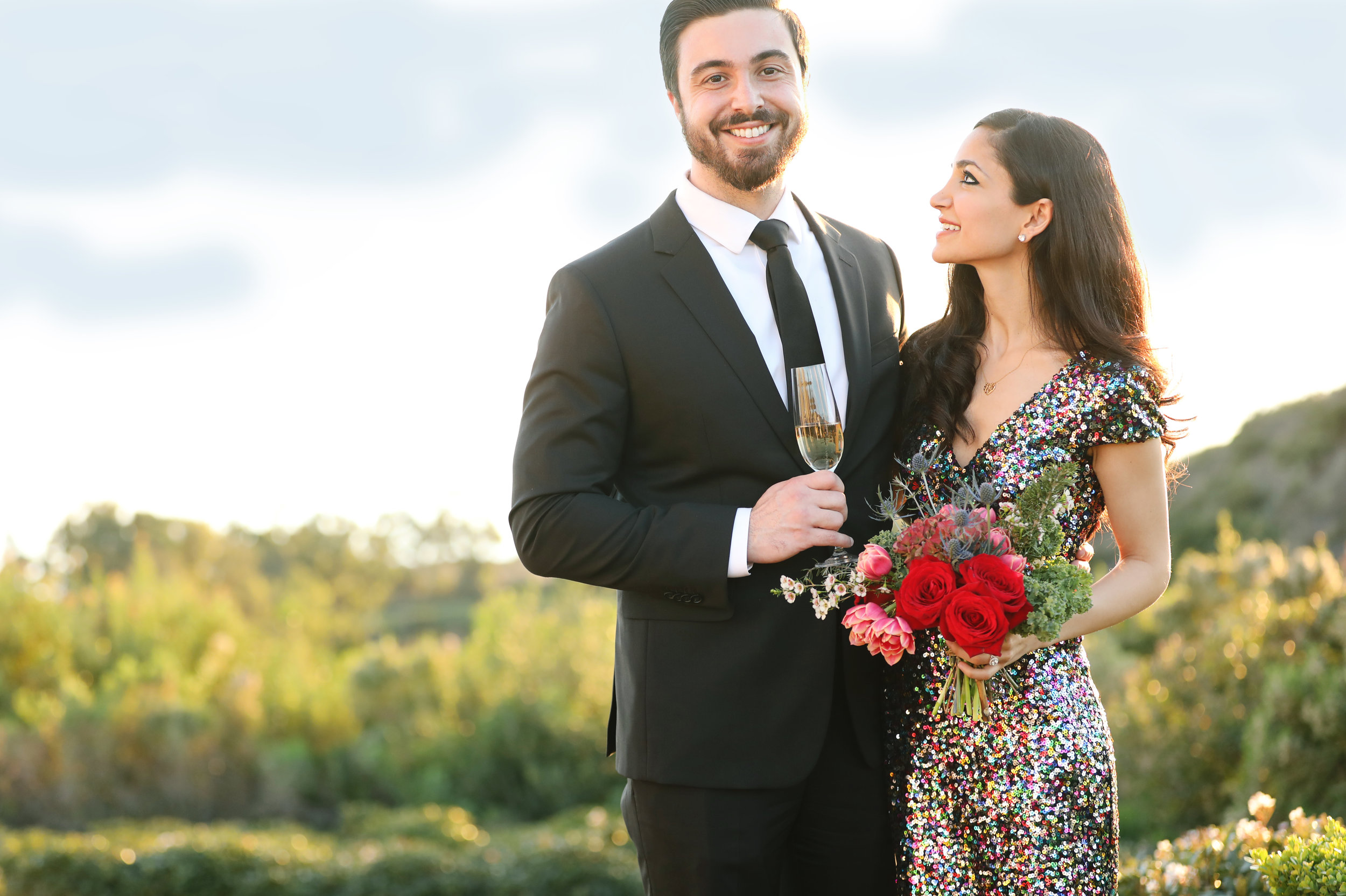 Red roses and champaign for this engaged couple as they are photographed in Orange County.