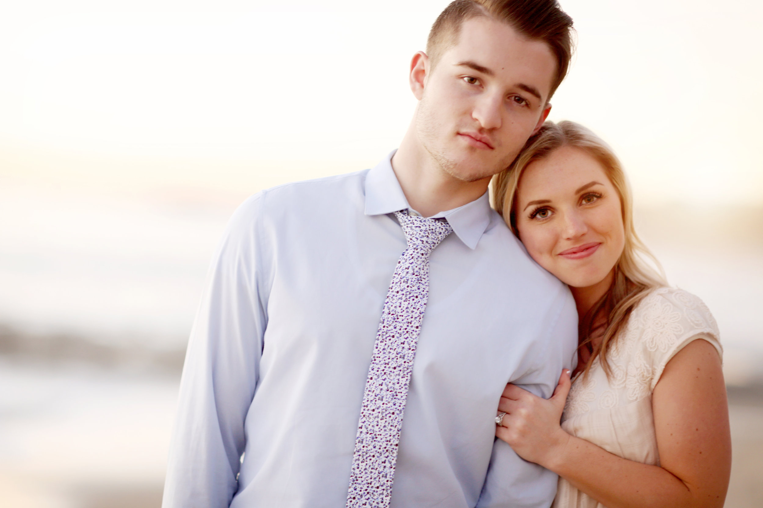 Rolling waves are the backdrop for this engagement beach image.