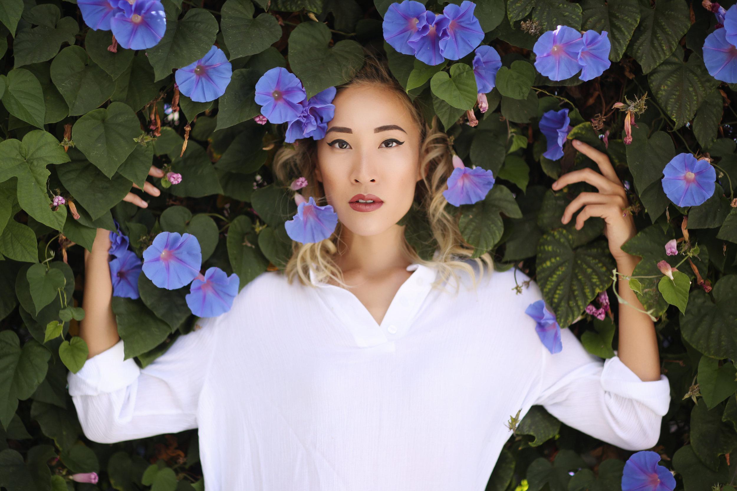Feast Fashion Faves Amanda Nguyen portrait in the morning glory flowers