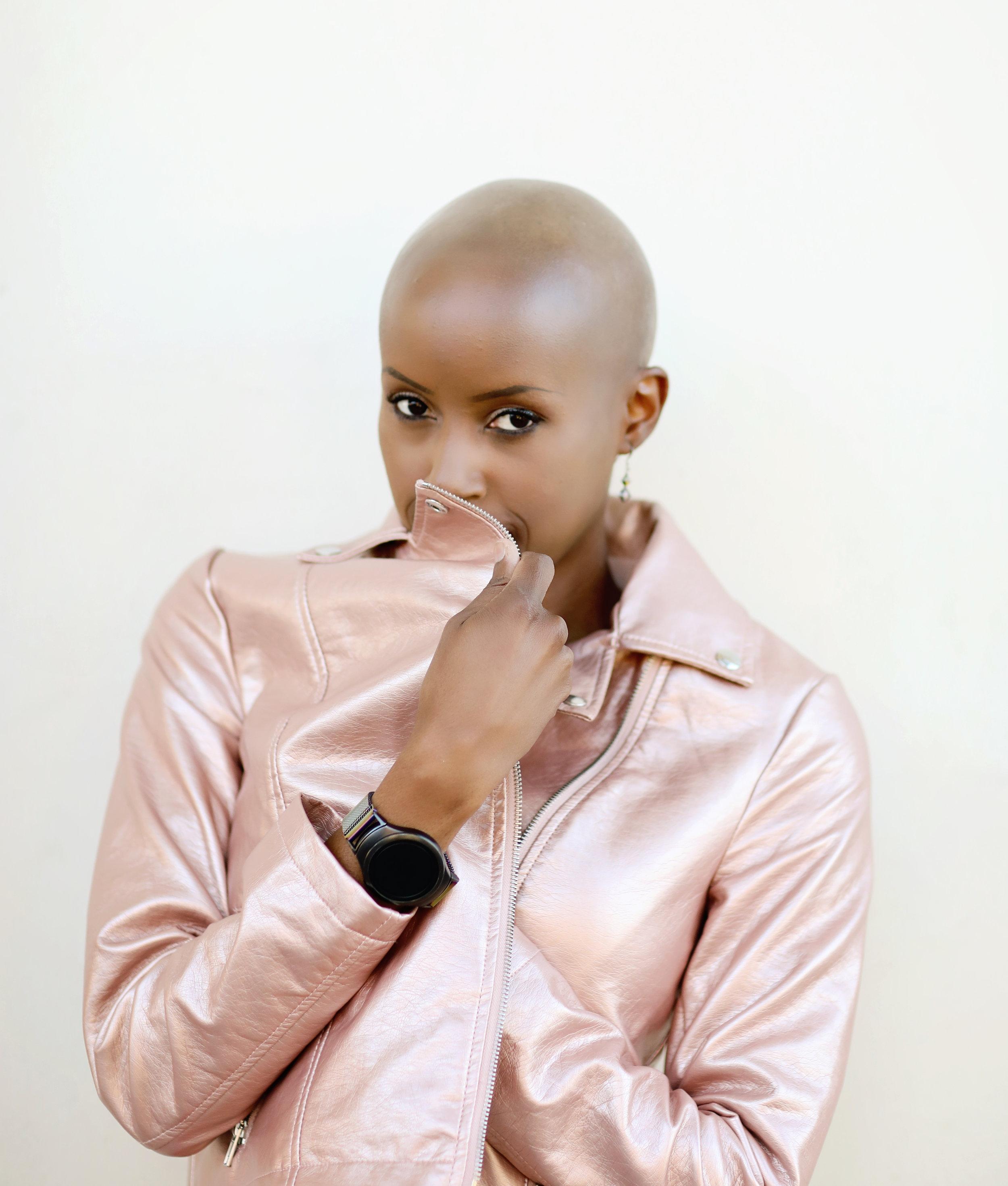 Fashion model wearing pink leather jacket