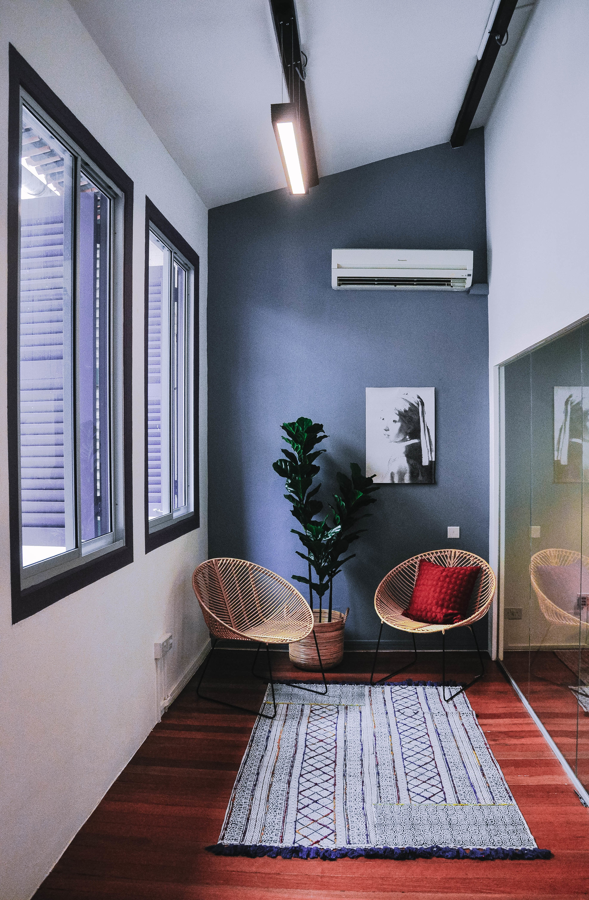 Funky Trendy Shophouse Office Design Feature Wall Rattan Chair