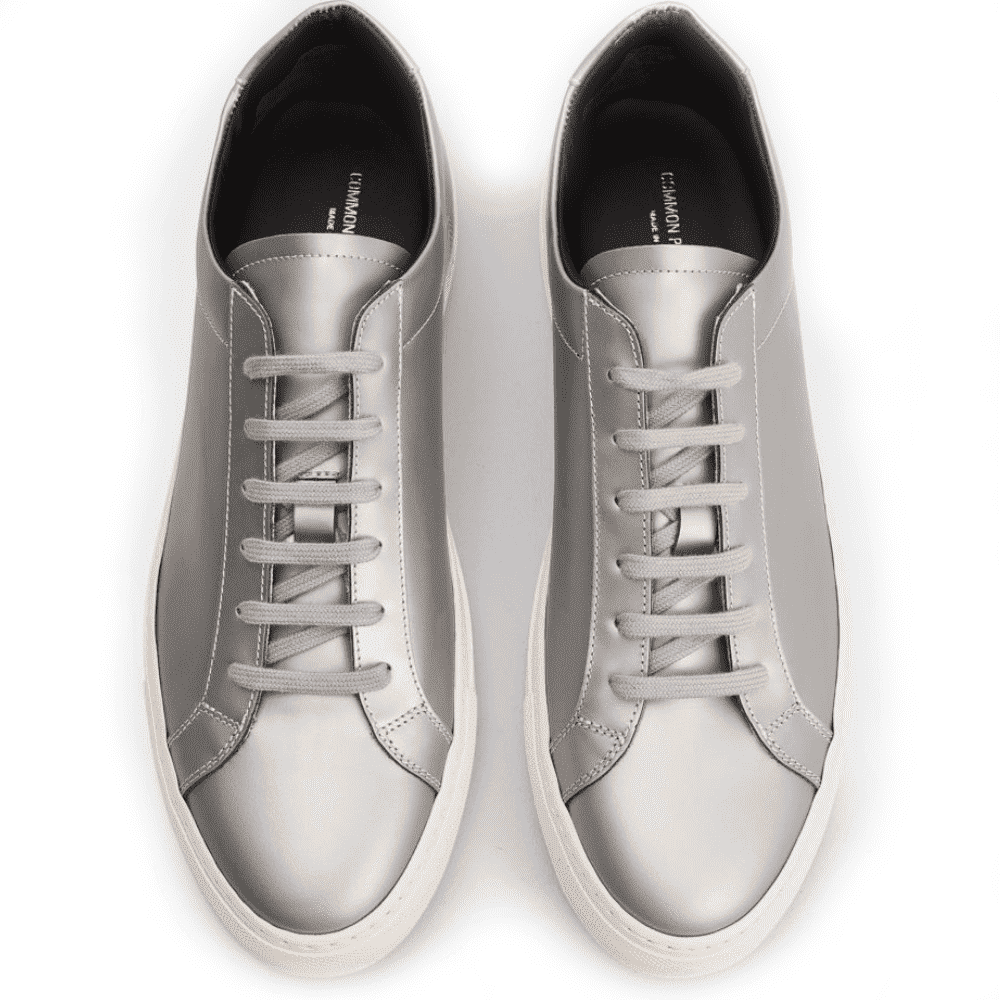 COMMON PROJECTS ACHILLES - As if corduroy and straight leg trousers weren't classic enough. Common Projects achilles are thrown into the mix with an updated muted silver color.SELLOUT RISK: LOW MED HIGHPurchase now at tres-bien.com for $475.00. -20% VAT