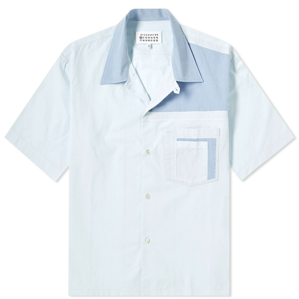 Maison Margiela Cut & Sewn Vacation Shirt - This camp-collar shirt from Margiela has the perfect mix of workwear and vacation aesthetics. That's not easy to accomplish because work and vacation in the same sentence is not said often.SELLOUT RISK: LOW MED HIGHPurchase now at endclothing.com for $375.00