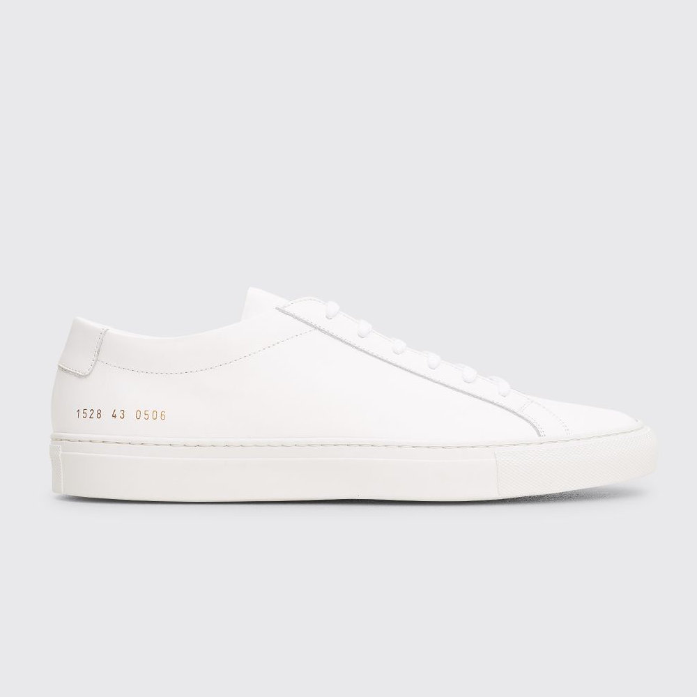 Common Projects Achilles In White Leather - The epitome of white leather sneakers. Every guy should own at least one pair of Common Projects.SELLOUT RISK: LOW MED HIGHPurchase now at tres-bien.com for $328.00