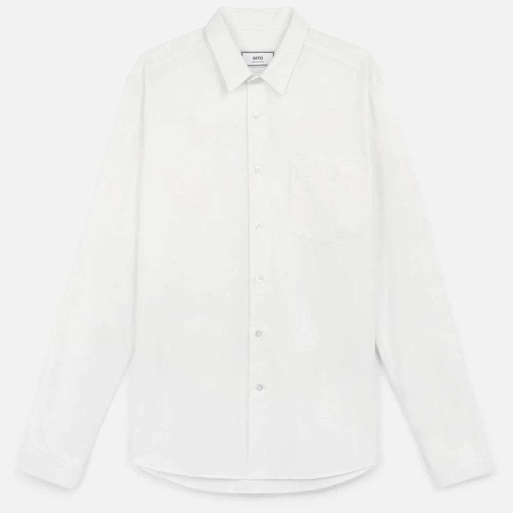 AMI Paris Pocket Shirt - A simple white shirt can do so much in many outfits. What makes this shirt the go to white shirt is the all natural blend of fabric consisting of 86% cotton, 10% linen and 4% rayon.SELLOUT RISK: LOW MED HIGHPurchase now at amiparis.com for $255.00