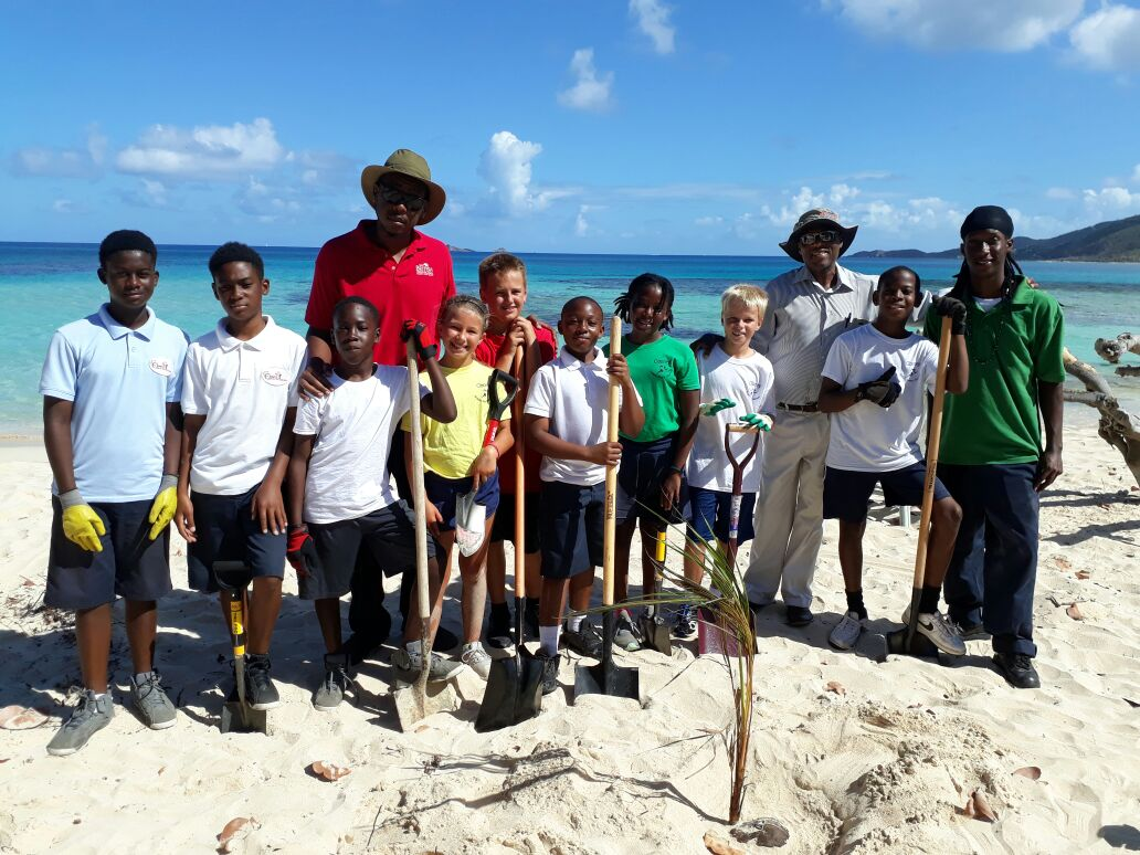 Children from Ciboney Centre of Excellence, with Sister Island Officer Jassiem Maynard, District Officer Verne Wheatley and Jahnai Caul at Savannah Bay, Virgin Gorda