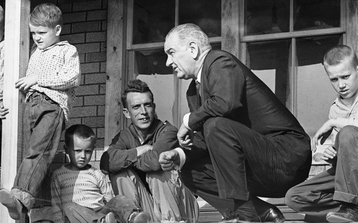 President Lyndon Johnson visits a family living in poverty in 1964. Photo by Walter Bennett/Time & Life Pictures/Getty Images