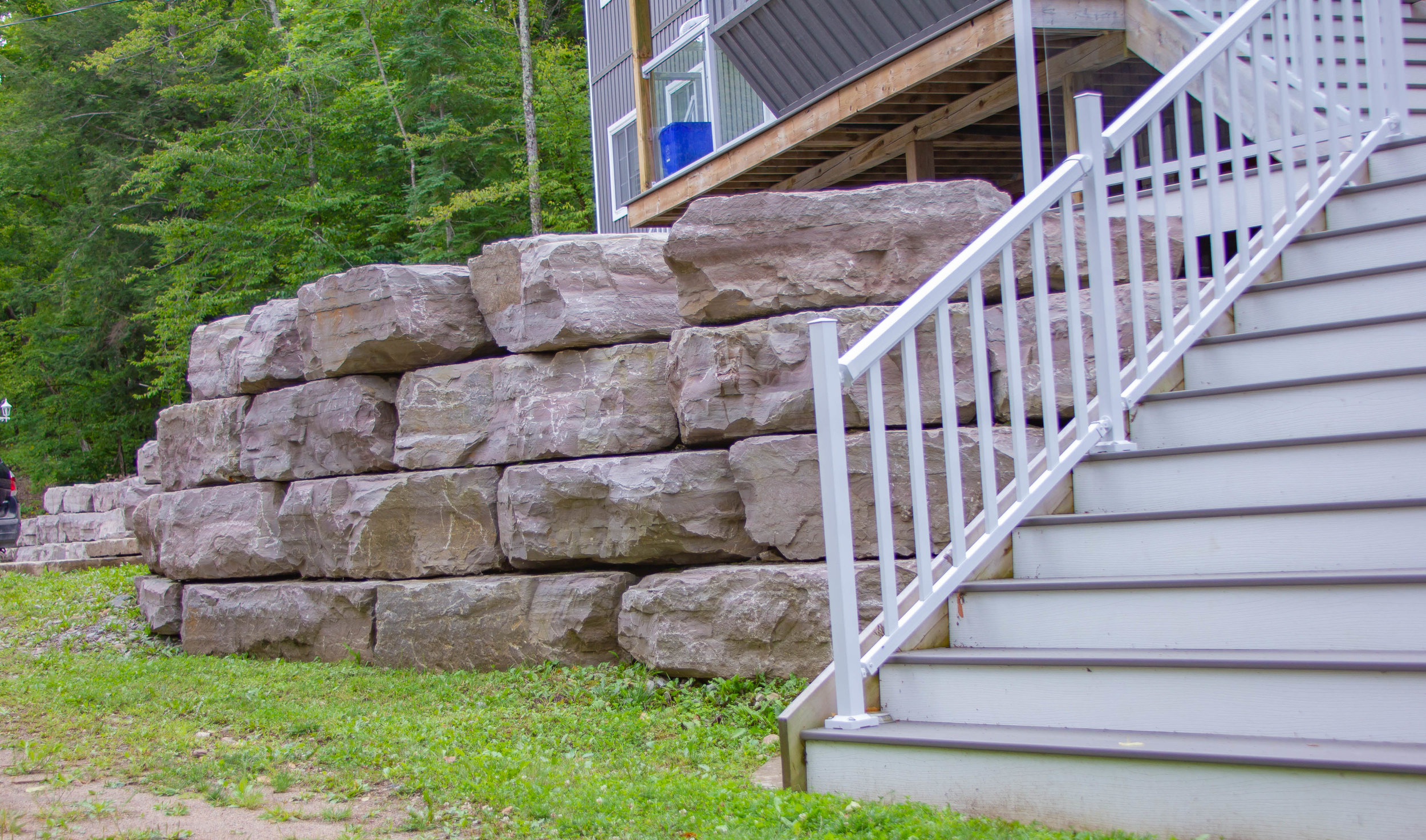 Stone Retaining Wall Against House